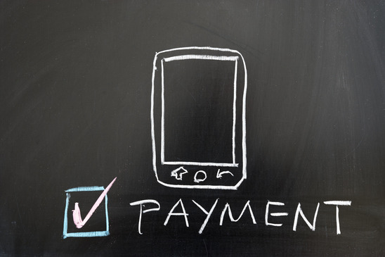 Payment by mobile concept drawing on the blackboard